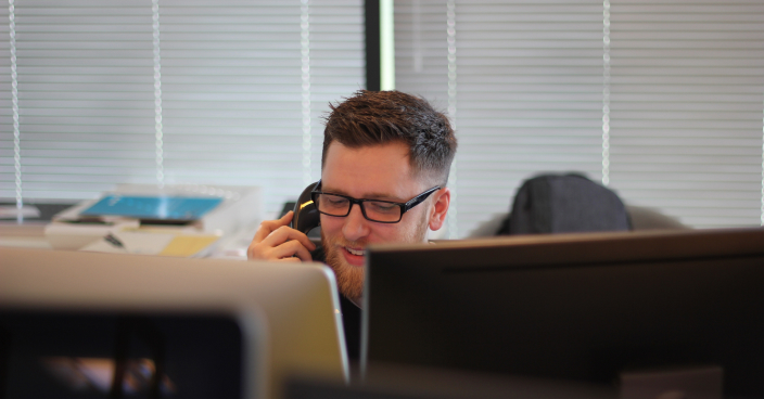 Man on the phone in an office.