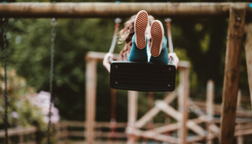 Girl swinging on swing.